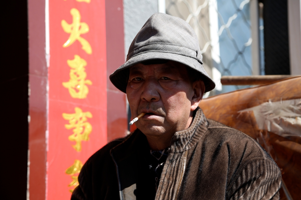 china village man smoking